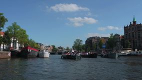Typical street view in Amsterdam - the popular canals in the city center - AMSTERDAM - THE NETHERLANDS - JULY 19, 2017. Typical street view in Amsterdam - the stock video footage