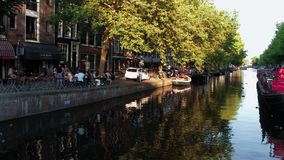 Typical street view in Amsterdam - the popular canals in the city center - AMSTERDAM - THE NETHERLANDS - JULY 19, 2017. Typical street view in Amsterdam - the stock footage