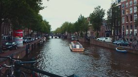 Typical street view in Amsterdam - the popular canals in the city center. Amsterdam - Holland stock video