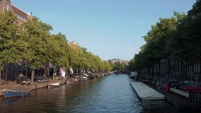 Typical street view in Amsterdam - the popular canals in the city center. AMSTERDAM - HOLLAND stock footage