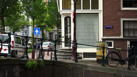 Typical street view in the canal area of Amsterdam  City of Amsterdam. Typical street view in the canal area of Amsterdam  Amsterdam Netherlands videoclip stock footage