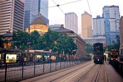 A typical street view with buildings and tram in Hong Kong. A typical street view with high rise buildings and tram in Hong Kong royalty free stock photos