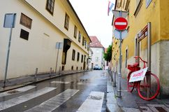 Typical Street in Zagreb Croatia in a Rainy Day. Typical small town   street in Zagreb ,Croatia with historic buildings Royalty Free Stock Photo