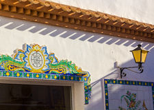 Typical streetlight tiles with drawings of southern Spain royalty free stock images