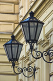 Typical stylish lanterns on 19th century neoclassic building dominant in Vienna Stock Photos