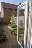 Typical suburban back garden from UK housing estate. Typical suburban back garden from a UK housing estate. Modern British home simple courtyard garden in royalty free stock photos