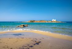 Typical summer image of an amazing pictorial view of a sandy beach and an old white church in a small isl Stock Image