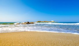 Typical summer image of an amazing pictorial view of a sandy beach and an old white church in a small isl Royalty Free Stock Photography