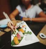 Sushi time!. Typical sushi dish with hosomaki, nigiri and big rolls royalty free stock photo