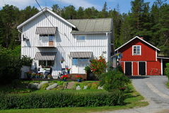 Typical Swedish house. A typical Swedish wooden house painted white and/or red in a small fishing village in Sweden royalty free stock photos