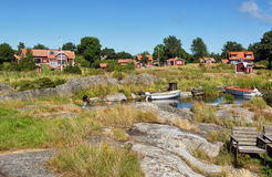 Typical Swedish village with red houses. Royalty Free Stock Images