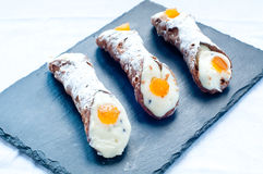 Typical sweet Italian consist cannoli , baba. And pastries stock photos