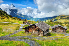 Typical Swiss alpine farmhouses and Eiger mountains,Bernese Oberland,Switzerland Royalty Free Stock Image