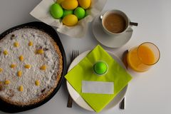 Studio photograph of Easter breakfast or brunch with Swiss Easter cake in green and yellow pastel colors stock photo