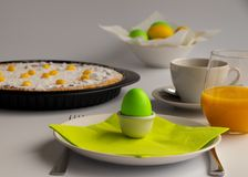 Studio photograph of Easter breakfast or brunch with Swiss Easter cake in green and yellow pastel colors stock photos