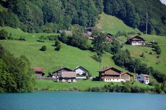 Typical Swiss houses. Along a lake stock photos