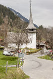 Typical Swiss village on valley. Stock Photo