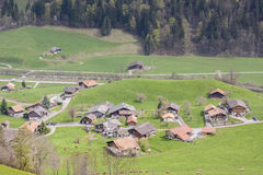 Typical Swiss village on valley. Stock Photography