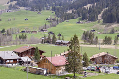 Typical Swiss village on valley. Royalty Free Stock Photo