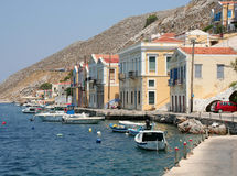 Typical Symi Houses and Boats by the Sea Stock Photography