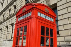 Typical telephone booth in london stock photos