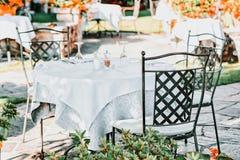 Typical terrace restaurant table romantic luxury Ascona town. Typical terrace restaurant table in romantic luxury Ascona town on Lake Maggiore, Ticino canton stock photos