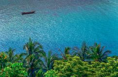 Long-tail boat mooring in a small bay on Koh Samui, Thailand stock photos