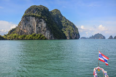 Typical Thailand Picture: Cliffs In The Sea With The Thai Flag Royalty Free Stock Photo