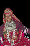 Typical Tharu dancer, wearing traditional jewelry and clothes, Nepal Stock Images