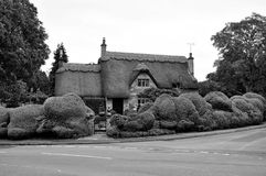 Typical Thatched Cotsworld House within the Cotswold district of Gloucest royalty free stock photos