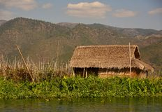 Thatched Hut on Inle Lake royalty free stock photography