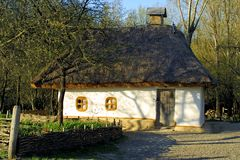 Typical thatched roof house. In Ukraine stock photography