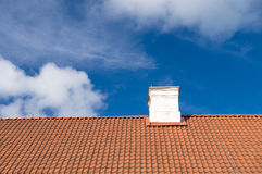 Typical tiled roof and white chimney Royalty Free Stock Images