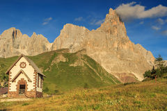 Typical Tirolian chapel in the Dolomites,Cimon Della Pala,Italy. Chapel and mountains,Cimon Della Pala in background,Dolomites,Sudtirol,Italy Stock Photography