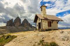 Typical Tirolian chapel in the Dolomites,Tre Cime Di Lavaredo (D. Chapel and mountains,Tre Cime Di Lavaredo in background,Dolomites,Sudtirol,Italy Stock Image