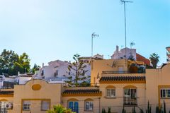 Typical town architecture in Andalusia, characteristic building. Facades, tourist place, sunny day Royalty Free Stock Image