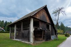 Typical traditional Alpine barn shed. Located in Slovenian touristic village Ribcev laz, next to the Bohinj lake Stock Photo
