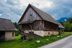 Typical traditional Alpine barn shed. Located in Slovenian touristic village Ribcev laz, next to the Bohinj lake Royalty Free Stock Photo