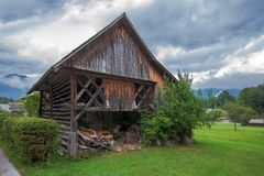 Typical traditional Alpine barn shed. Located in Slovenian touristic village Ribcev laz, next to the Bohinj lake Royalty Free Stock Image