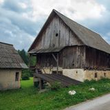 Typical traditional Alpine barn shed. Located in Slovenian touristic village Ribcev laz, next to the Bohinj lake Stock Image