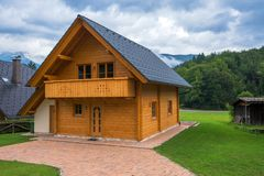 Typical traditional Alpine cottage cabin. Located in Slovenian touristic village Ribcev laz, next to the Bohinj lake Stock Image