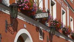 Typical traditional Austrian hotel. Zimmer frei, elegant european hotel with traditional austrian style, sign vacancy, flowers on each window stock video
