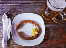 Typical traditional Bavarian meal, glilled sausage (wurst) and b Royalty Free Stock Image