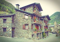 Typical traditional dark brick Andorra rural houses - postcard l Royalty Free Stock Images