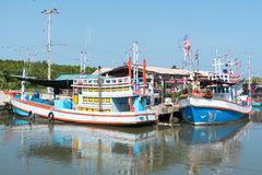 Typical Traditional Fishing Boats in a Harbour at Thailand and Blue Sky. Typical Traditional Fishing Boats in a Harbour at Phetchaburi, Thailand and Blue Sky Royalty Free Stock Image