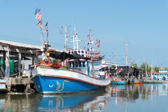 Typical Traditional Fishing Boats in a Harbour at Thailand and Blue Sky. Typical Traditional Fishing Boats in a Harbour at Phetchaburi, Thailand and Blue Sky Royalty Free Stock Photos