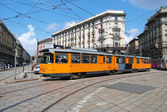 Typical tram (tramcar, trolley) in Milan square. Typical tram in Milan square. A tram, tramcar, trolley, trolley car, or streetcar is a railborne vehicle, of Royalty Free Stock Photos