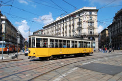 Typical tram (tramcar, trolley) in Milan square. Typical tram in Milan square. A tram, tramcar, trolley, trolley car, or streetcar is a railborne vehicle, of Stock Photography