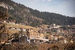 View of the town of Molveno in the Italian Alps. Typical Trentino houses with woods and green mountains royalty free stock photography