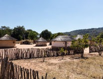 Typical tribal village in Zimbabwe. View of thatched mud homes in typical african village in Zimbabwe Stock Photos